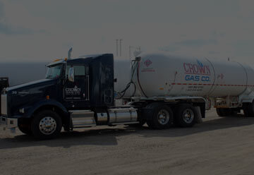 Row of Crown Gas propane delivery trucks