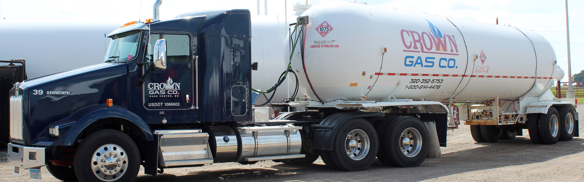 Semi-tractor pulling a large propane tank for commercial services