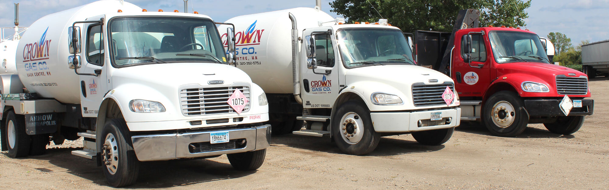 Row of Crown Gas propane delivery and service trucks