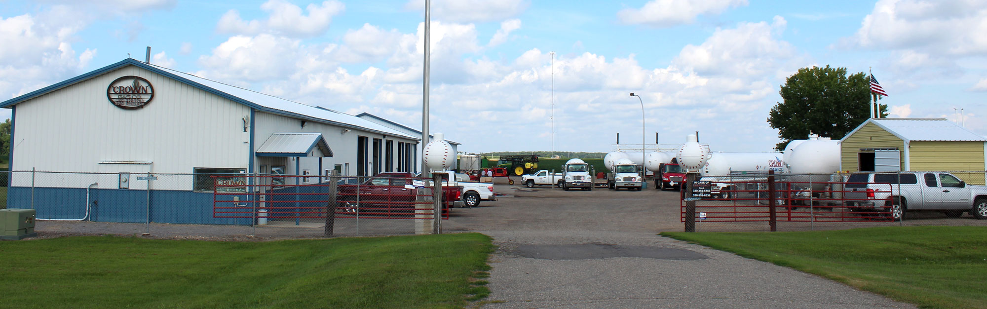 Crown Gas property showcasing the company building, propane tanks, and delivery trucks